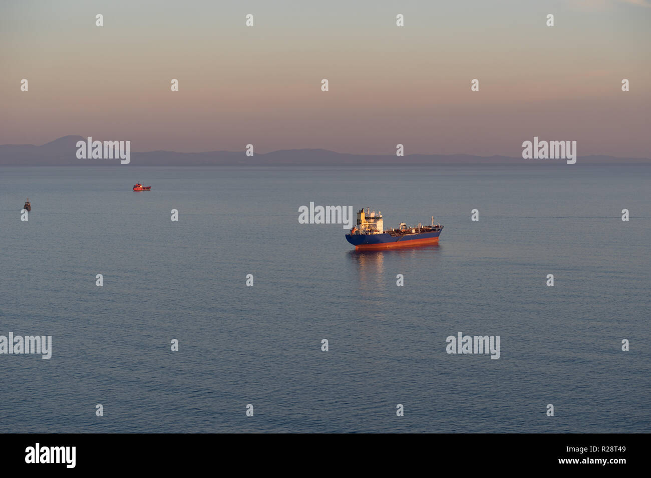Seascape with tanker and ships on the background of the sea and coastline. Vladivostok, Russia - Stock Image
