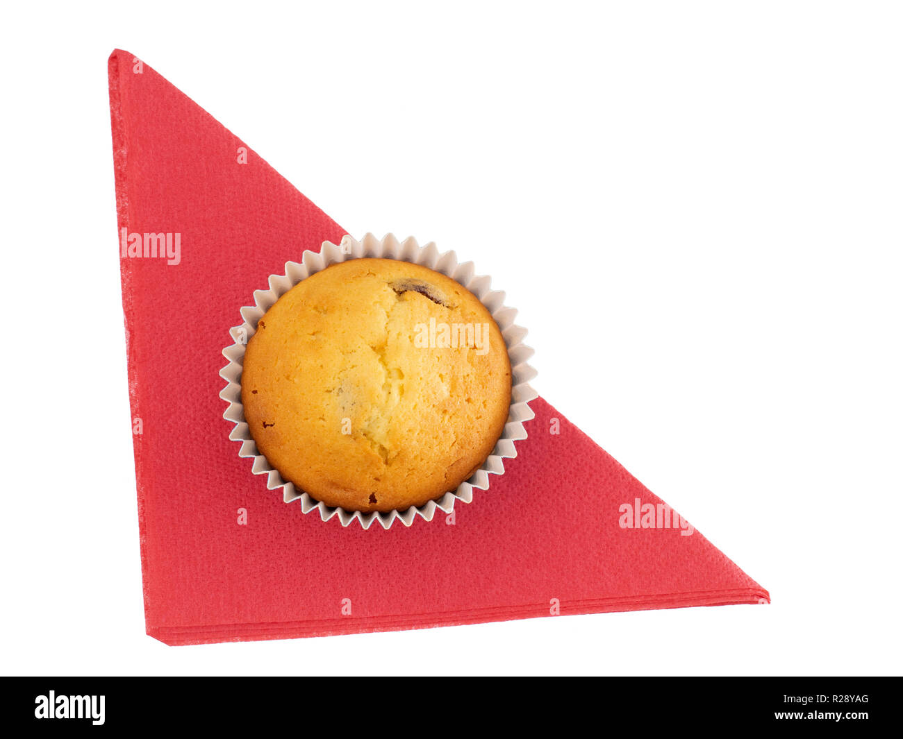 Homemade fruit muffin, cupcake on red paper serviette, napkin isolated on white. Small home baked cake, overhead view. - Stock Image