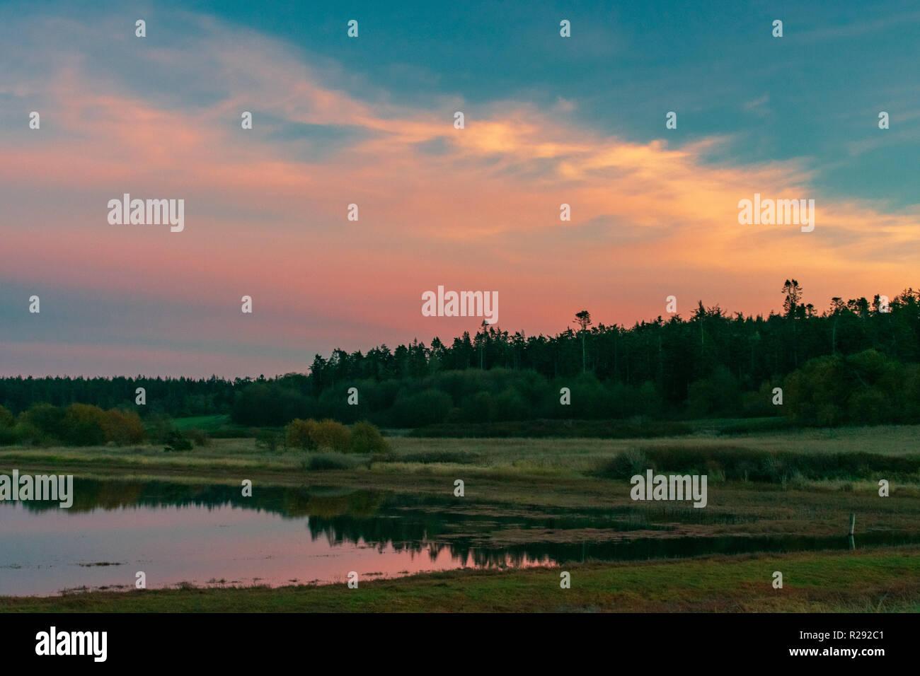 Sunset Reflecting In A Lake On Whidbey Island, Washington Stock Photo