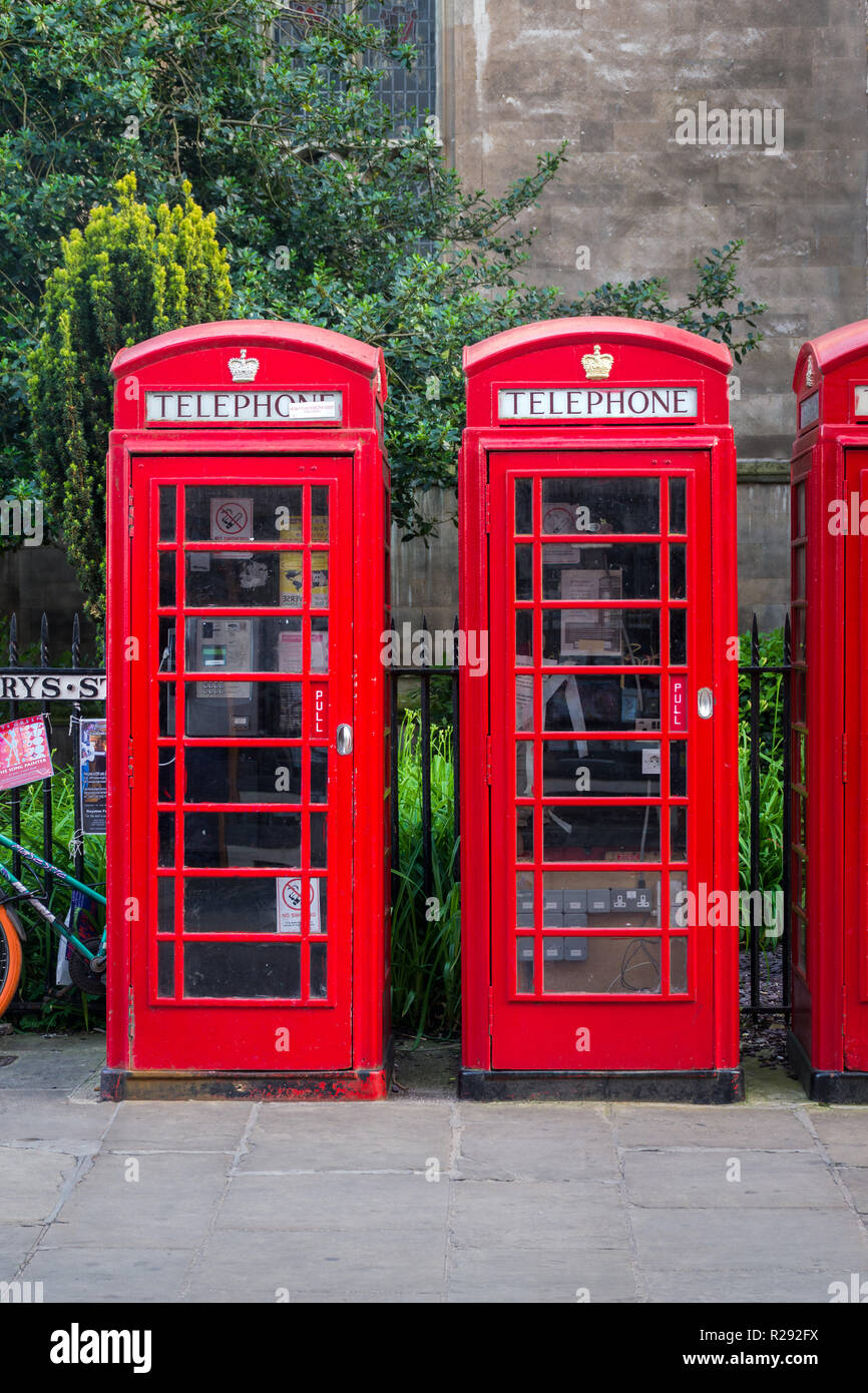 Two K6 red telephone boxes standing next to each other outside St Marys Church, Cambridge, UK - Stock Image