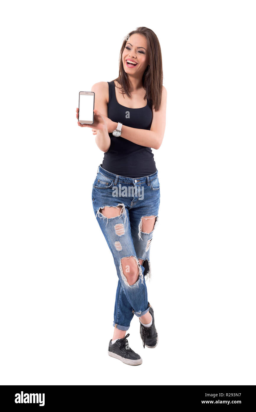 Young Beautiful Modern Woman Laughing And Showing Blank Mobile Phone Screen Full Body Isolated On White Background Stock Photo Alamy