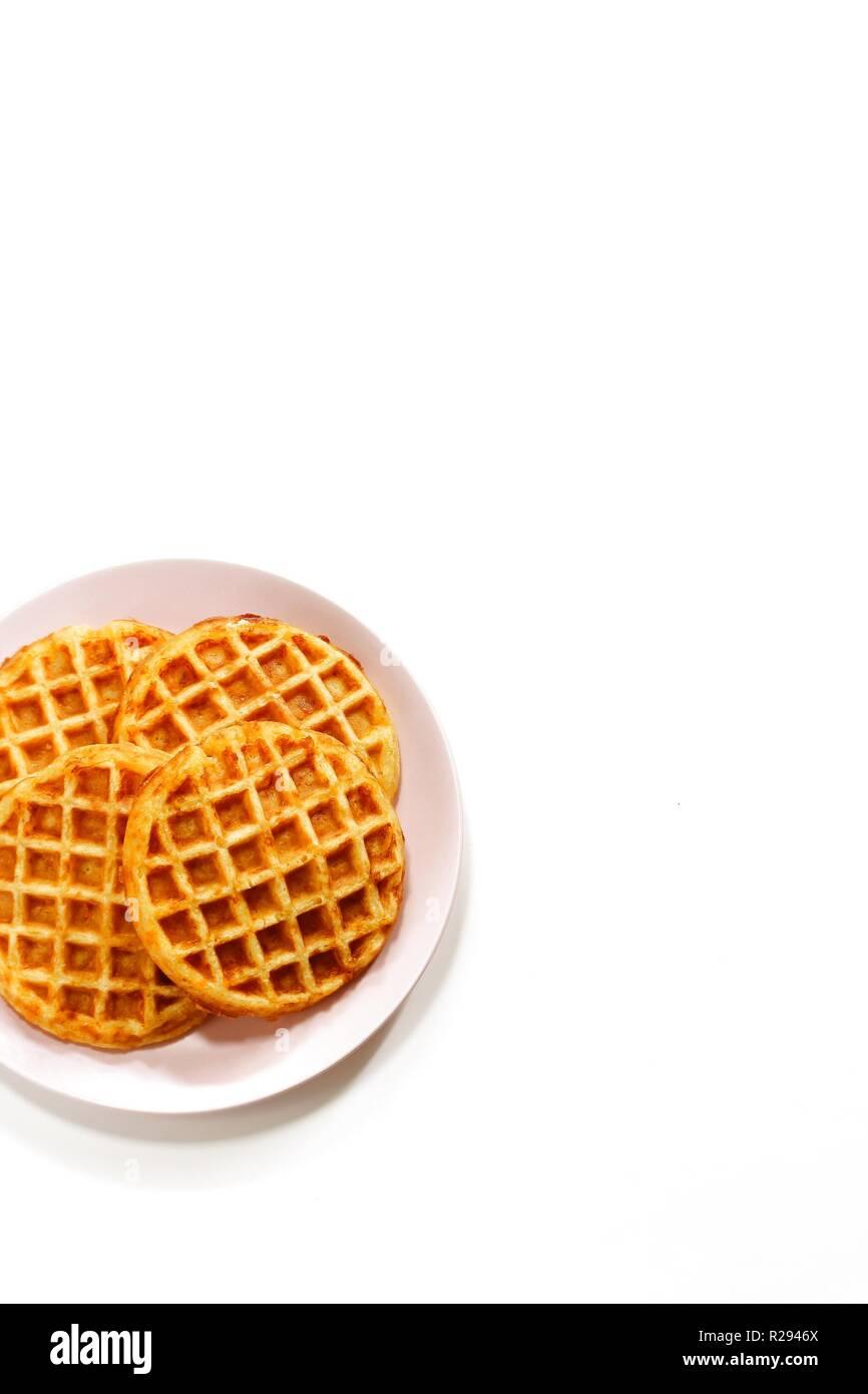 Pumpkin cornbread waffles isolated on white Stock Photo