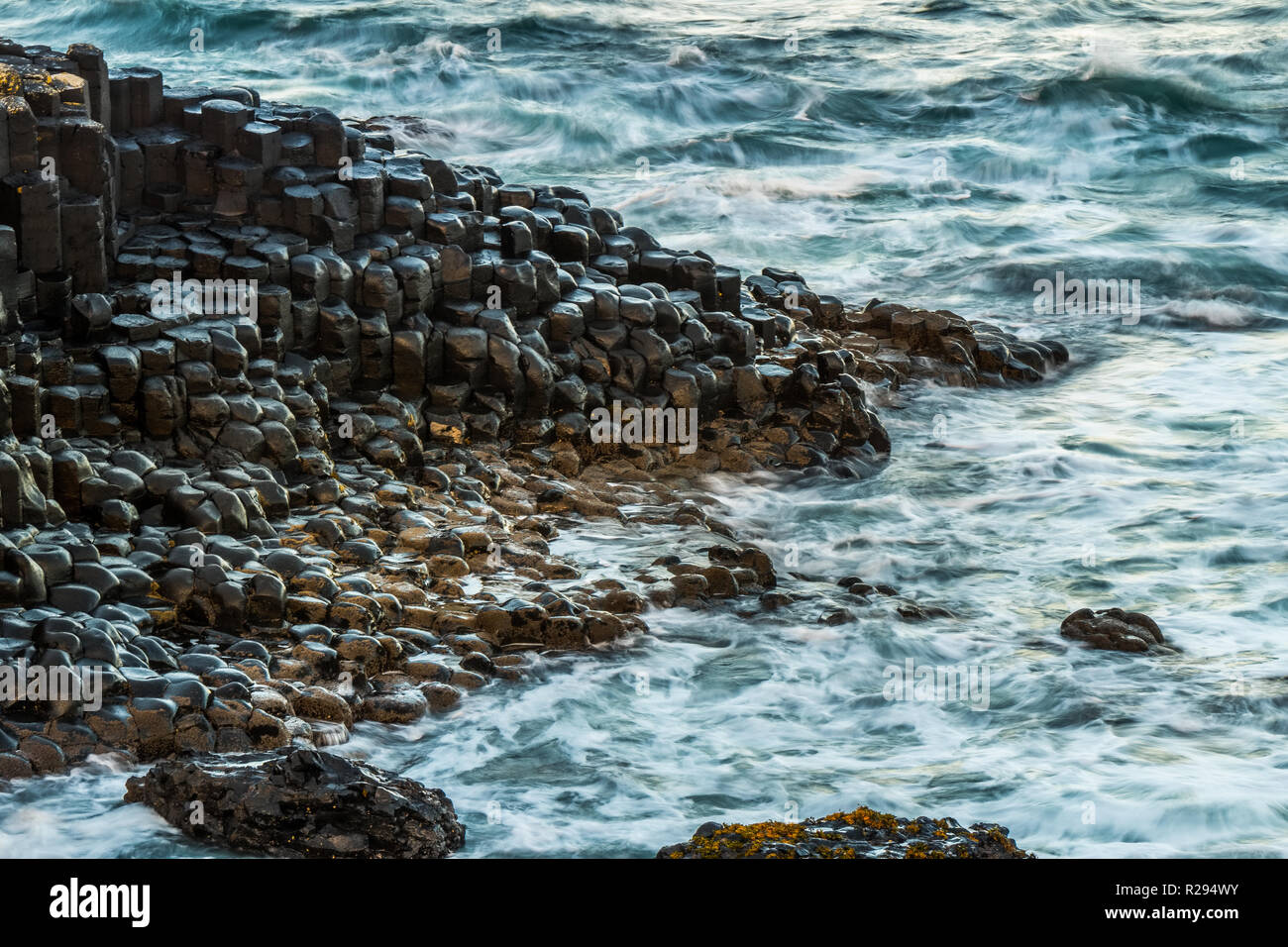 Landscape around Giant`s Causeway, A UNESCO world heritage site which has numbers of interlocking basalt columns result of an ancient volcanic fissure - Stock Image