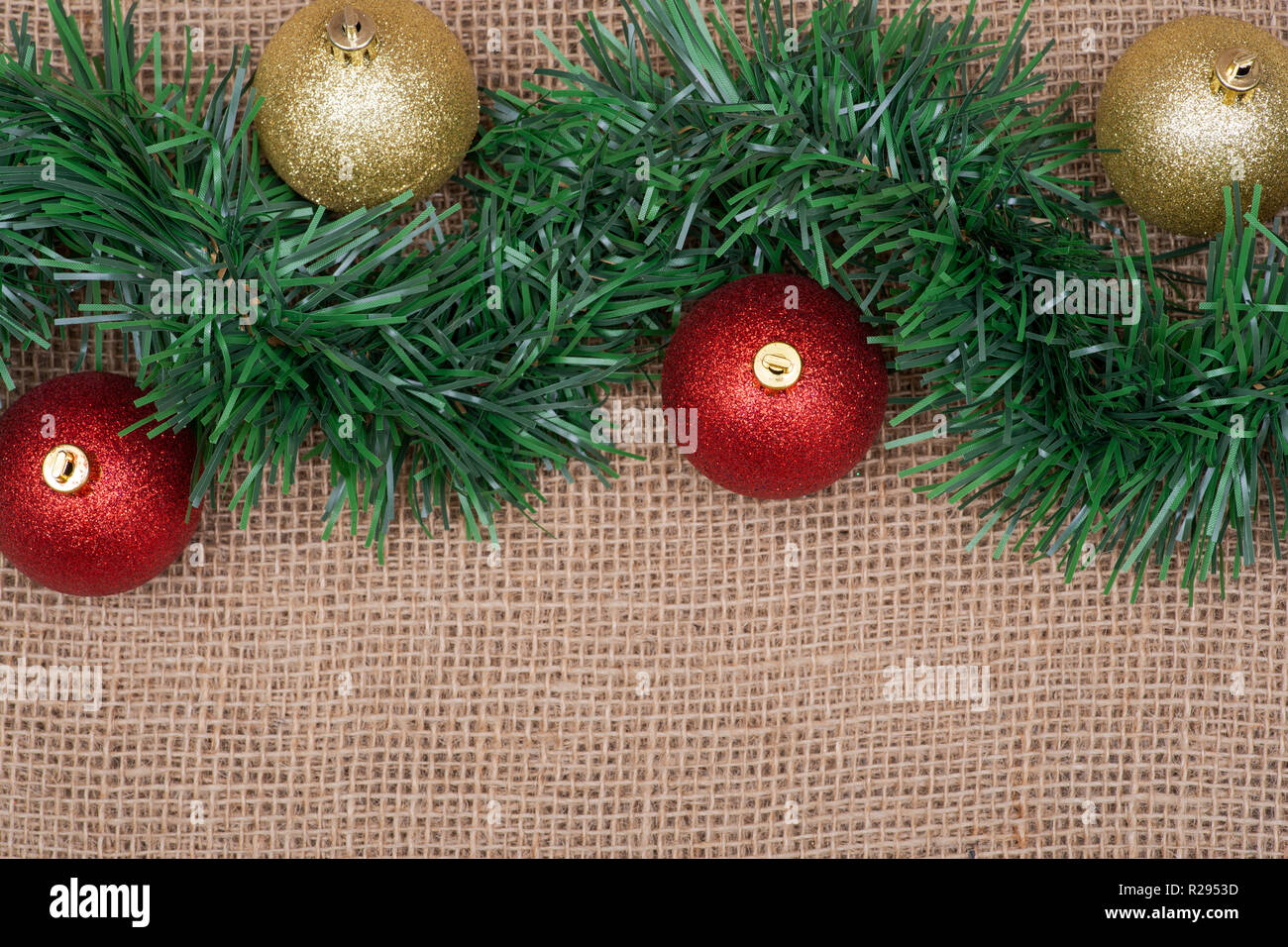 Winter Holiday Decoration Green Garland And Christmas Tree Balls On Burlap Background Stock Photo Alamy