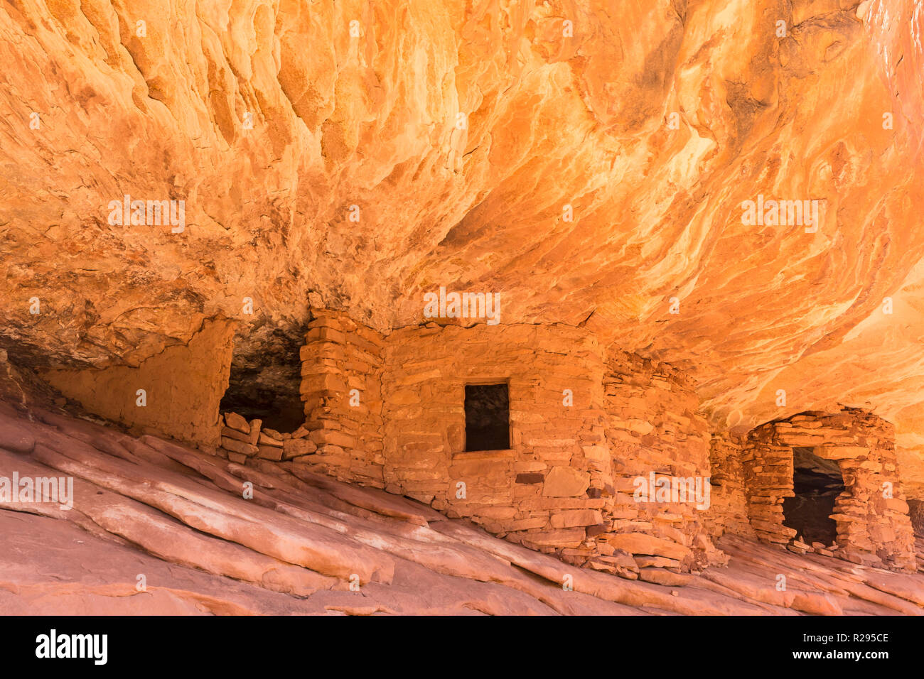 Puebloan ruins under  a cliff in Mule Canyon in the Cedar Mesa Plateau in Bears Ears National Monument in Utah look like the ancient stone granaries a - Stock Image