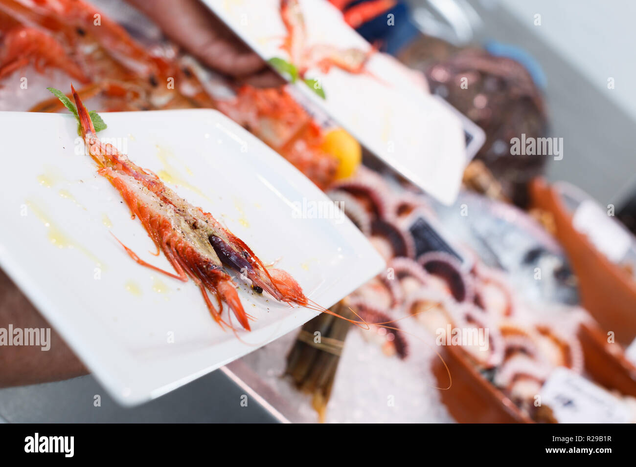 Closeup of fried big prawn with spices on white rectangular