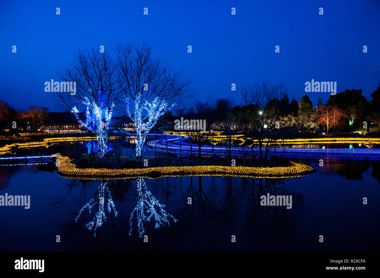 Light decoration reflecting on the water surface at Nabana no Sato, Mie, Japan - Stock Image
