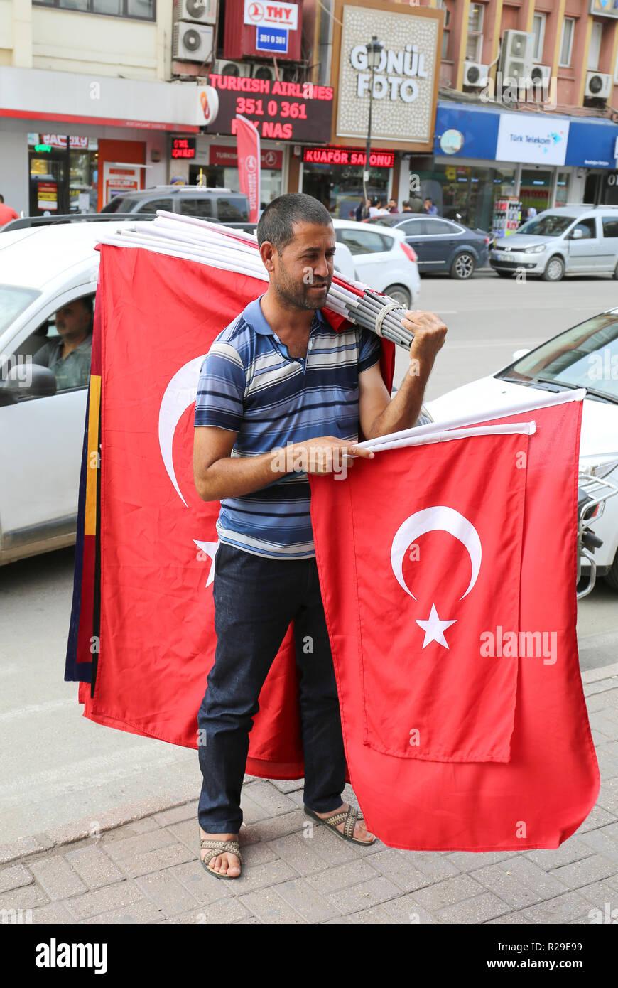 ADANA,TURKEY-OCTOBER 23:Unidentified Man selling Turkish Flags on street.October 23,2018 in Adana,Turkey. - Stock Image