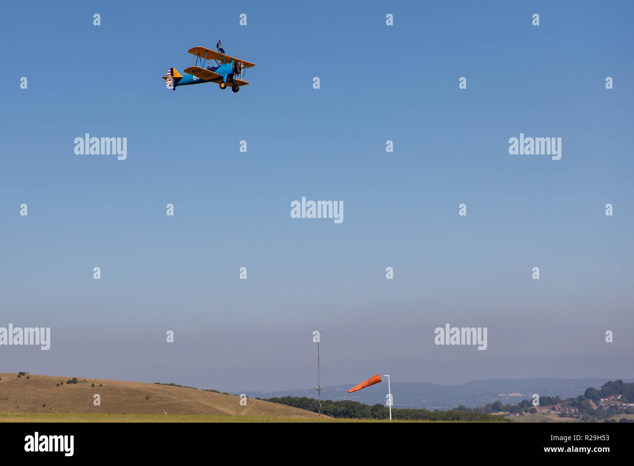 Wing walking on bi plane on summers day - Stock Image