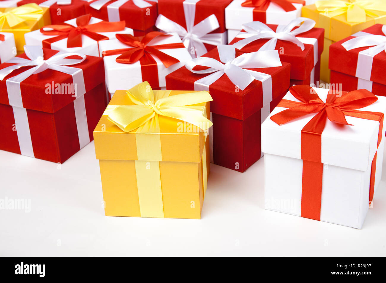 Red And White And Golden Gift Boxes Stay In Line With Copy Space