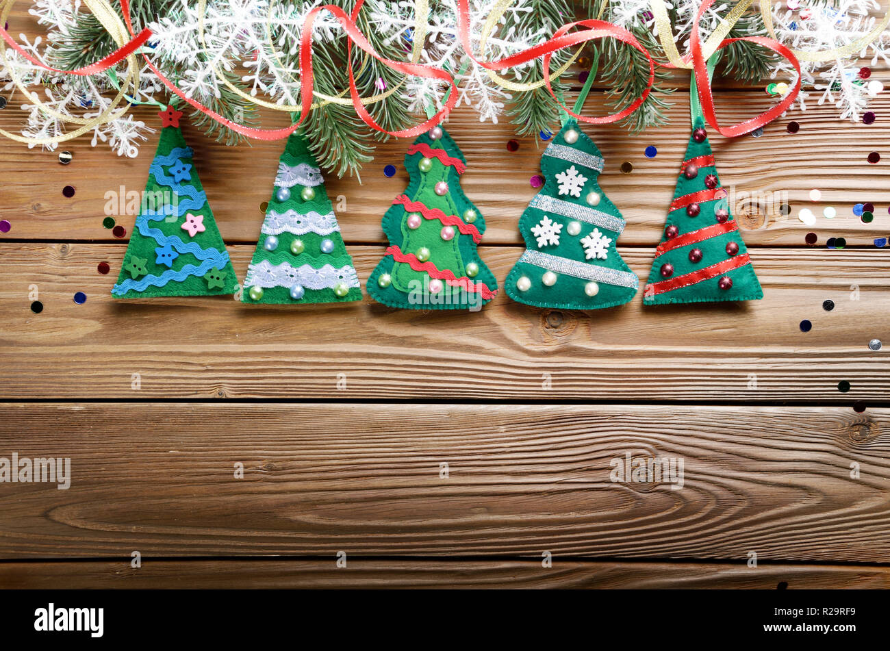Handmade Rustic Felt Christmas Tree Decorations As Background On Wooden Table Place For Text Stock Photo Alamy