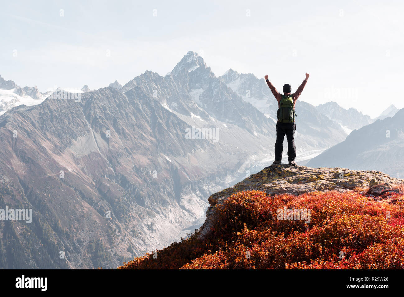 Amazing view on Monte Bianco mountains range with tourist on a foreground. Vallon de Berard Nature Preserve, Chamonix, Graian Alps. Stock Photo
