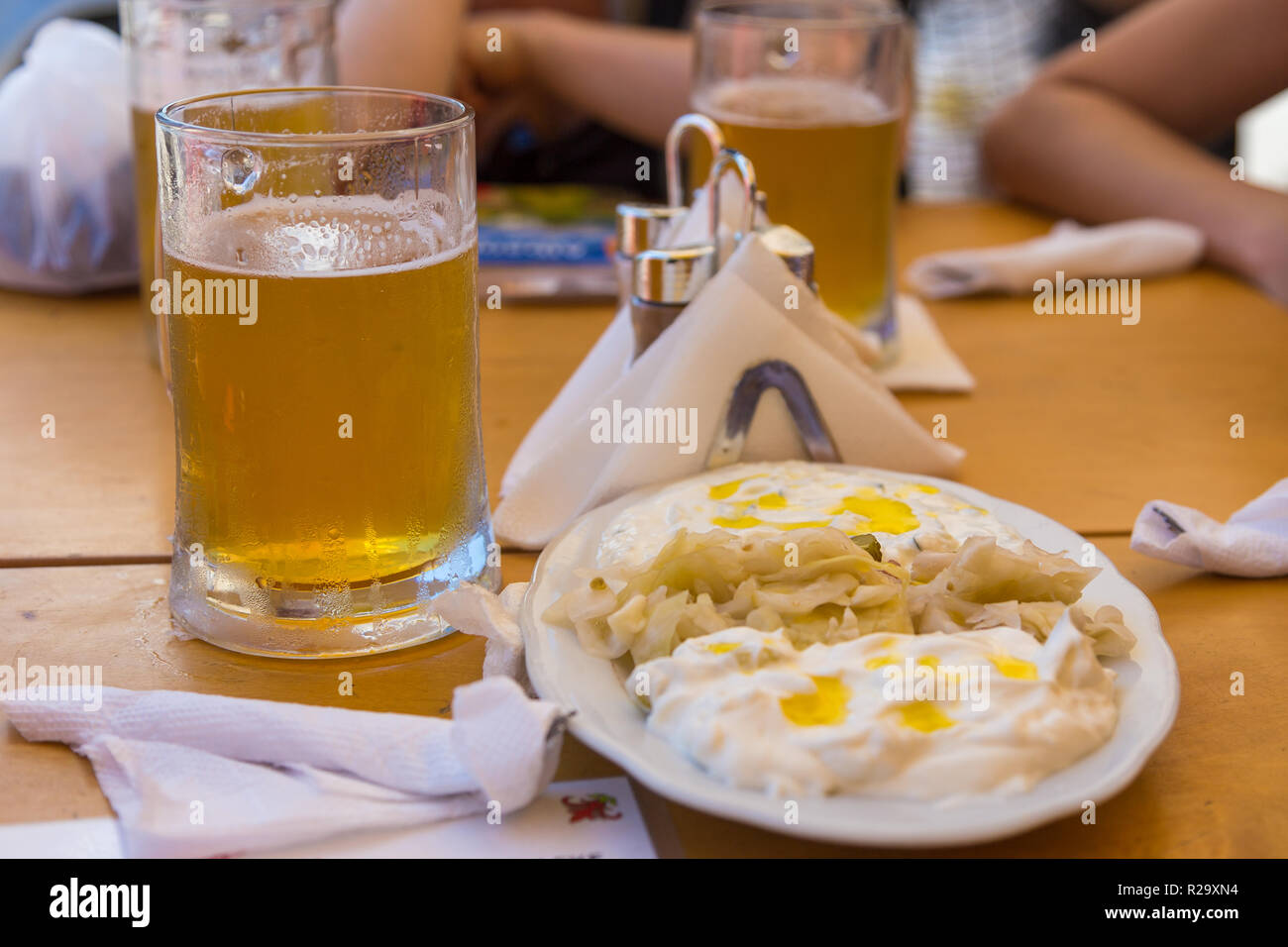 Traditional meal in Albania, cabbage with yoghurt. Beer mug in the background, Tirana, Albania. - Stock Image