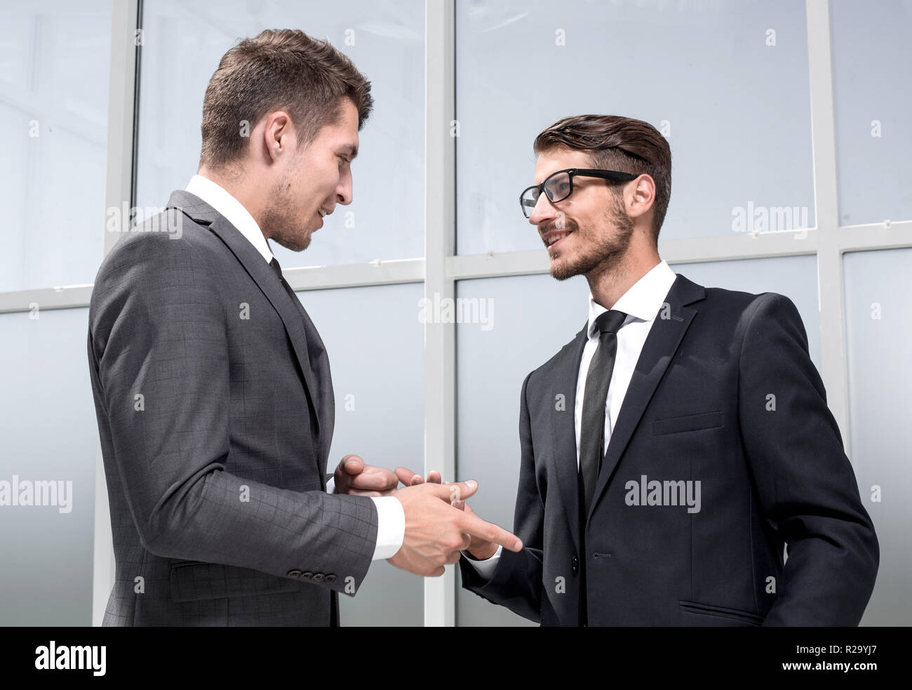 two businessmen posing - Stock Image