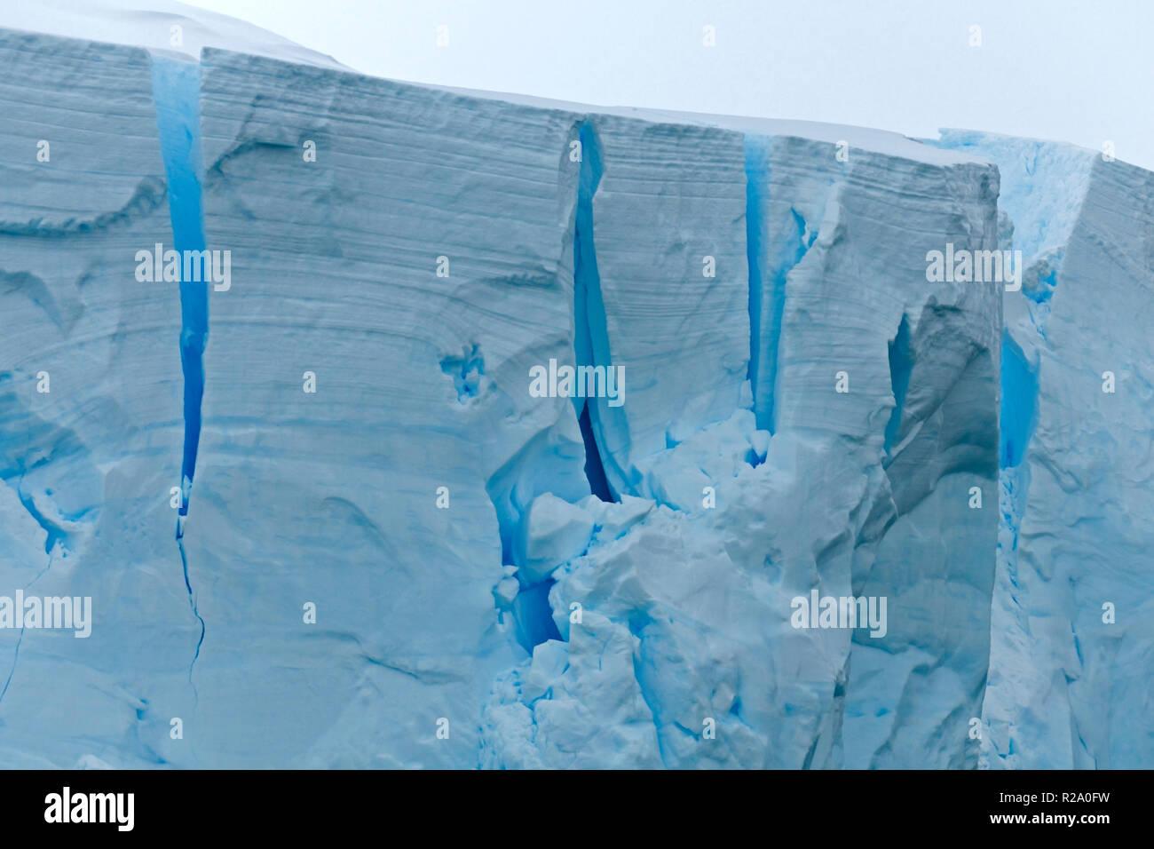 ice berg close up showing cracks and creates in ice antarctic peninsula antarctica - Stock Image