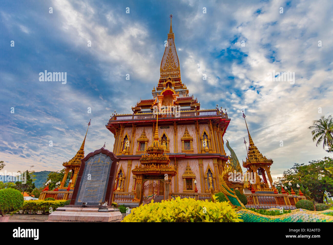sunset on pagoda of Chalong temple.Wat Chalong is the largest and most revered in Phuket. all tourists like to visit Chalong temple.The beautiful temp - Stock Image