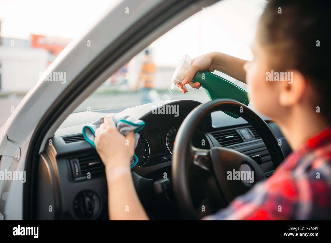 Female Person Polishes The Dashboard Of The Car Polishing Process