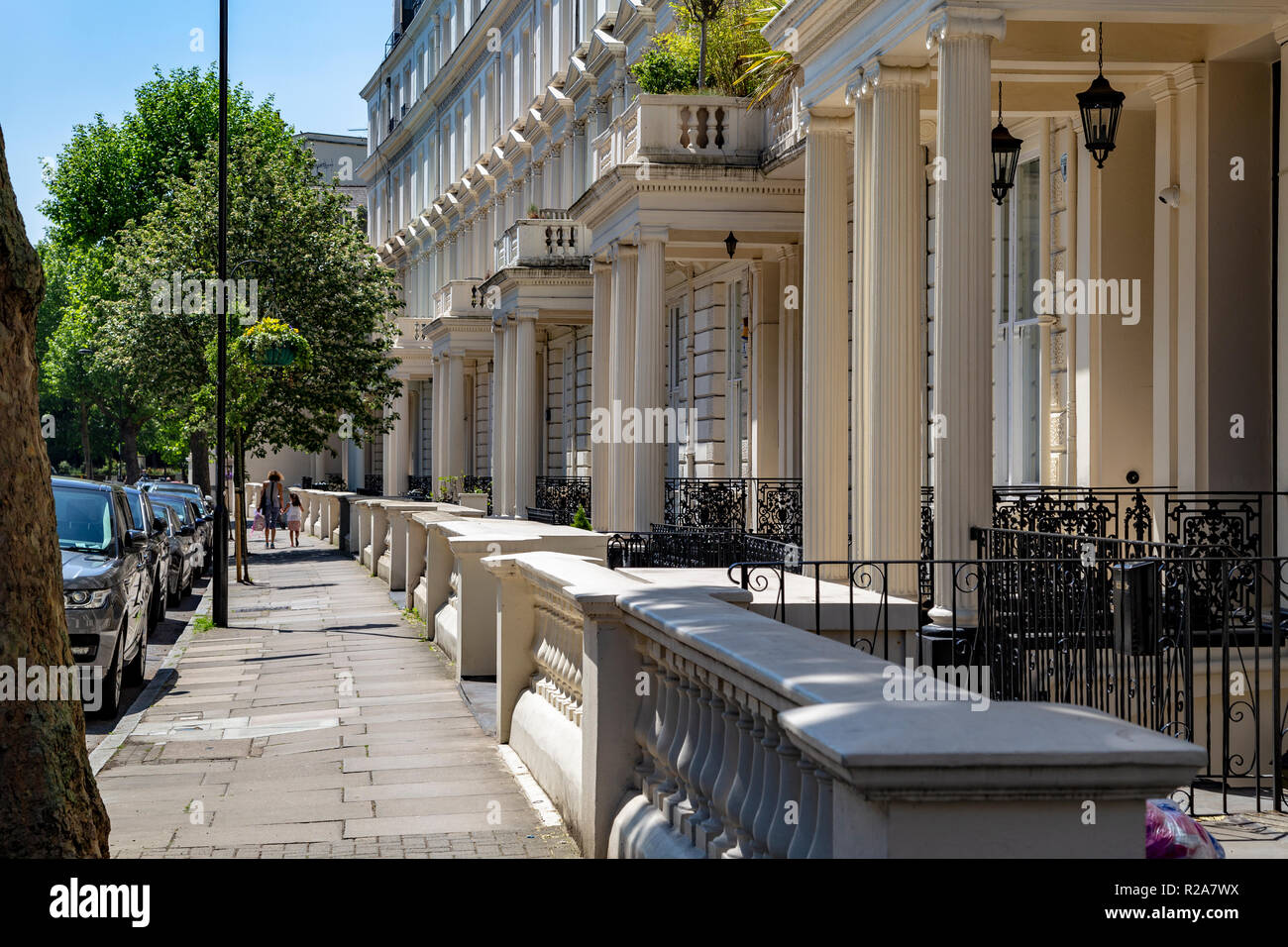 View of a row of colonnaded porch ways fronting houses in central London, United Kingdom - Stock Image