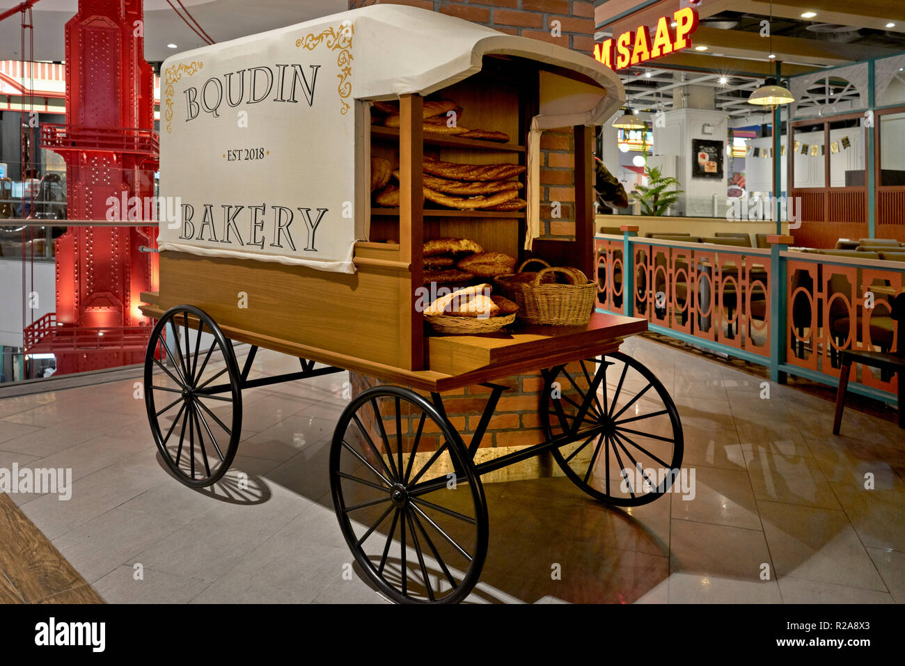 Replica vintage bakery and bread cart used as an advertising prop for artisan bakery shop. - Stock Image