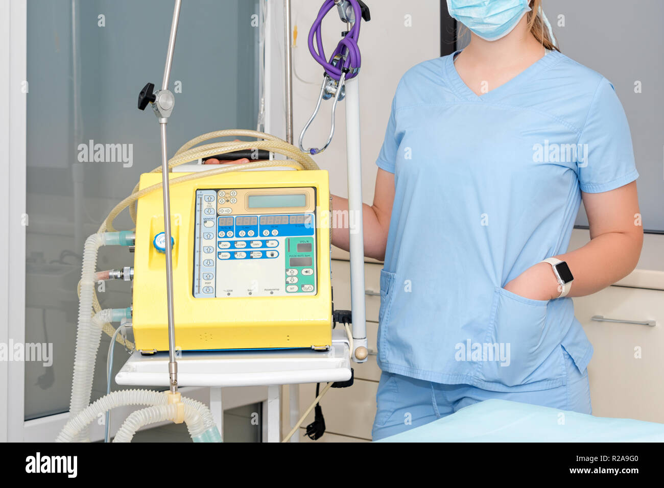 Anesthesiologist with anesthesiology device in operating room. Surgery assistant. - Stock Image