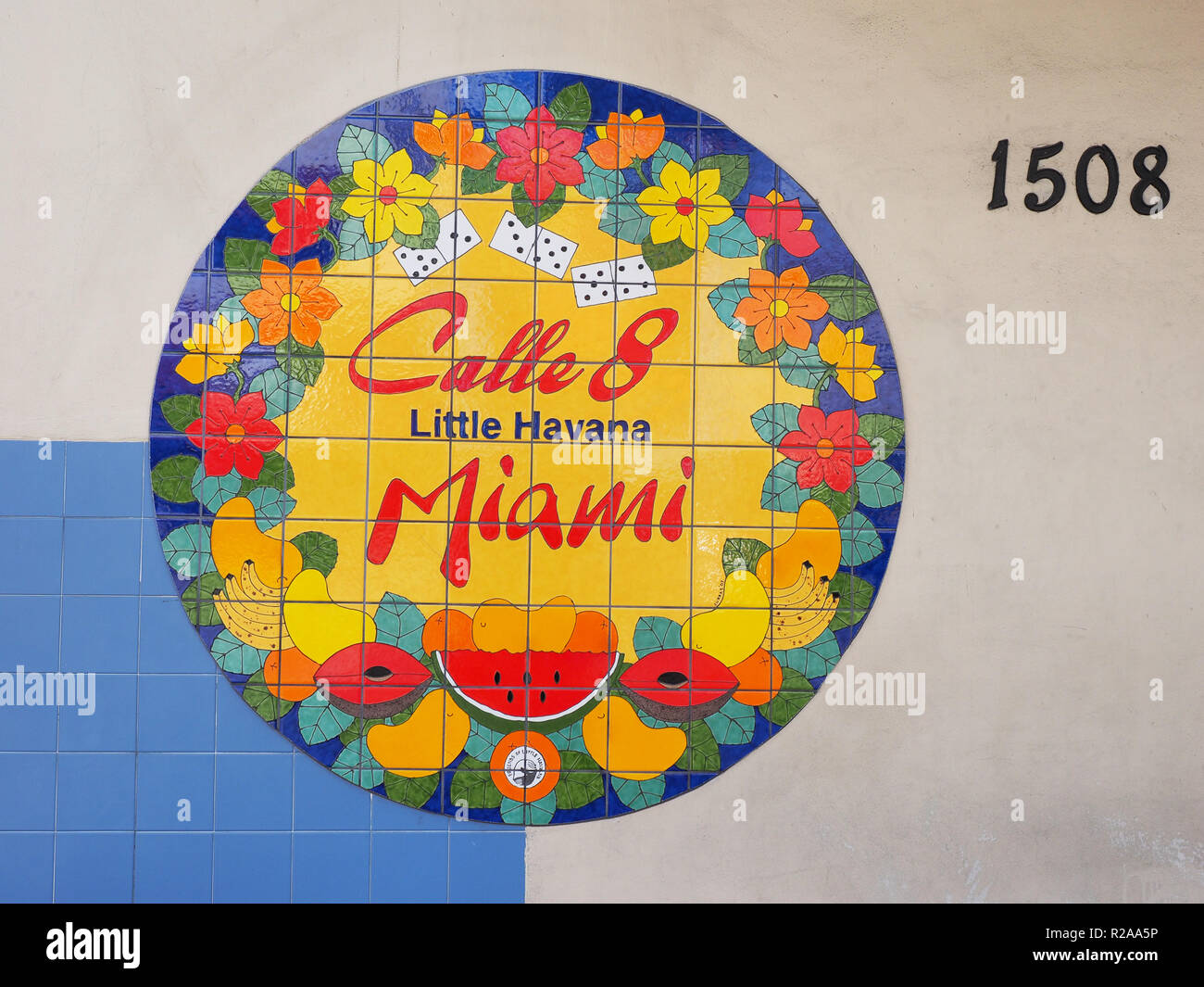 Miami, Florida 10-21-2018 Brightly colored Calle 8 - 8th Street -sign on a wall in Miami's Little Havana section. - Stock Image