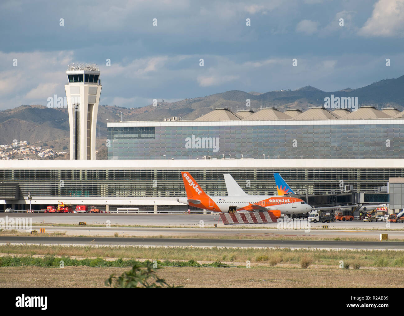 Málaga airport terminal 3 (opened in march 2010) and the control tower. - Stock Image