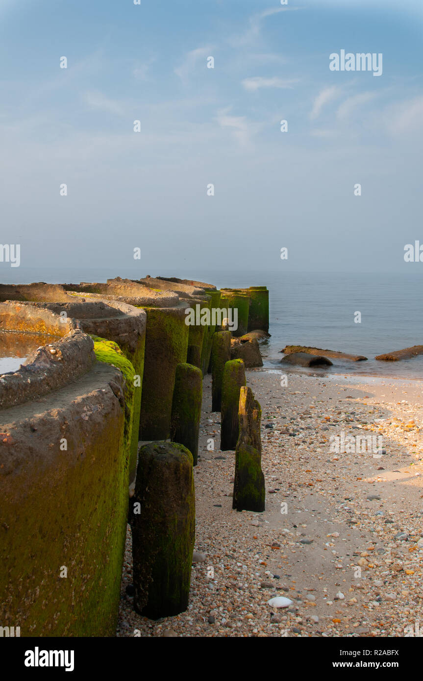 Decaying Cylinders on the Beach - Stock Image