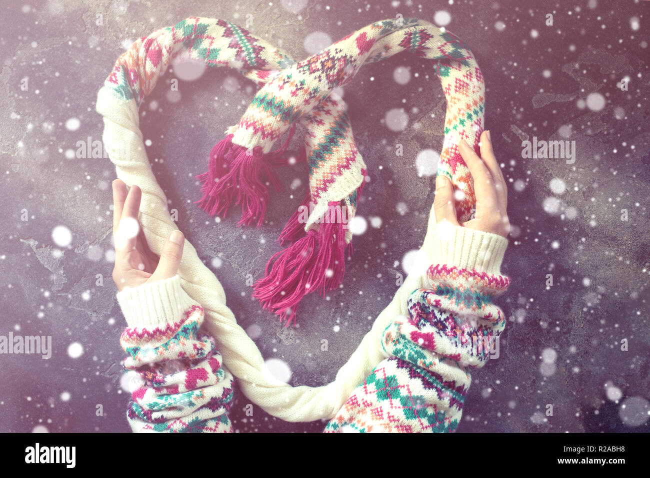 Heart made of a winter Christmas scarf - Stock Image