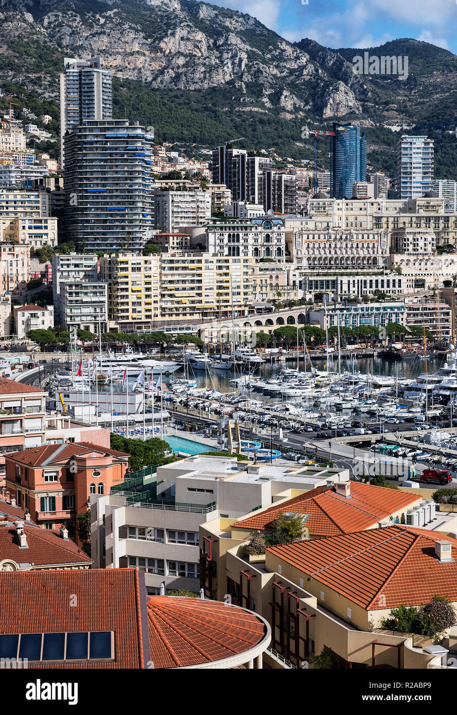 Cityscape and yachts docked in Port Hercule, Monaco. - Stock Image