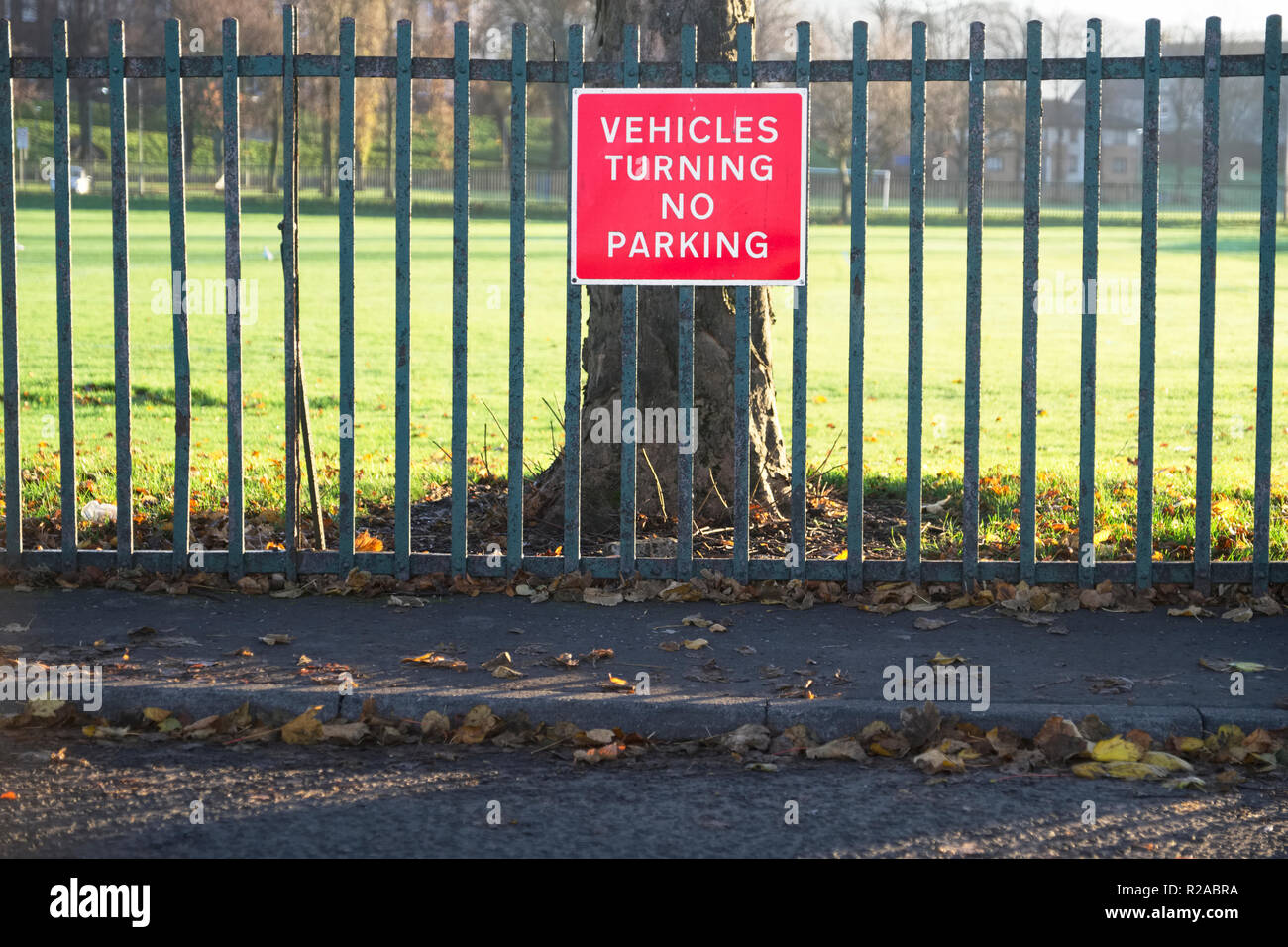No vehicles allowed turning or parking sign at road Stock Photo