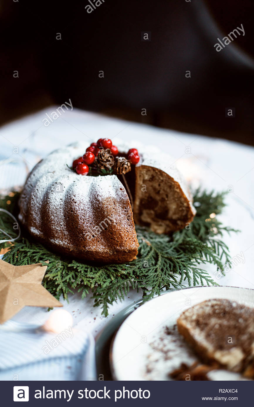 Christmas chocolate cake, pudding on white table with christmas decoration. Copy space. View from the top. - Stock Image