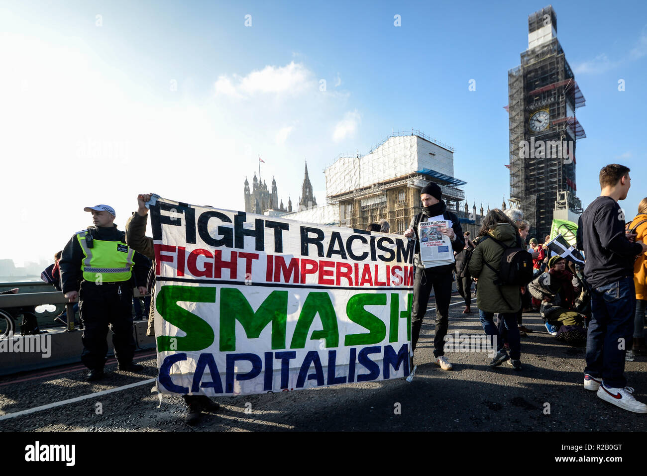 Extinction Rebellion protest to 'rebel against the British Government for criminal inaction in the face of climate change catastrophe' blocking bridge - Stock Image