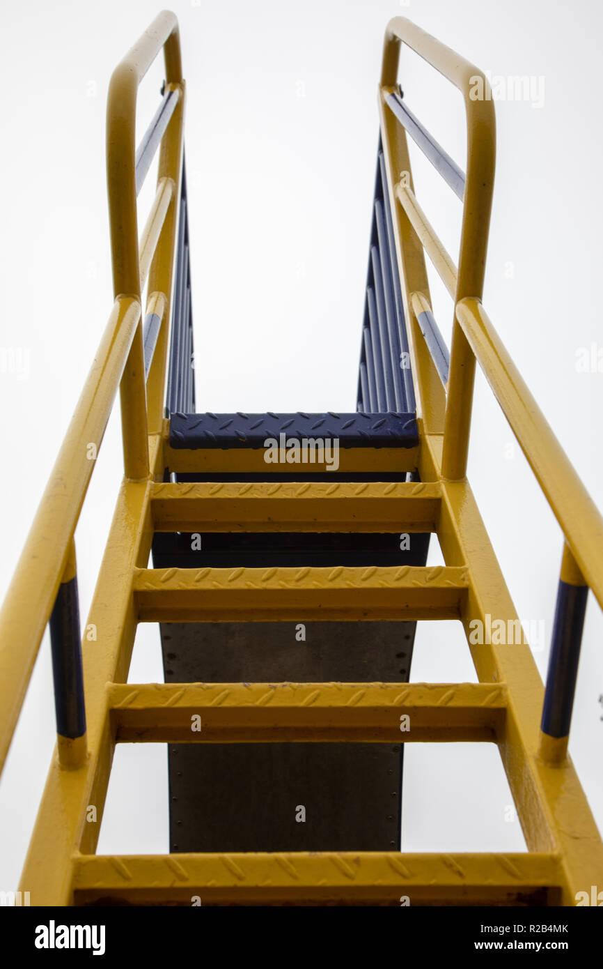 metal steps of a playground slide UK - Stock Image