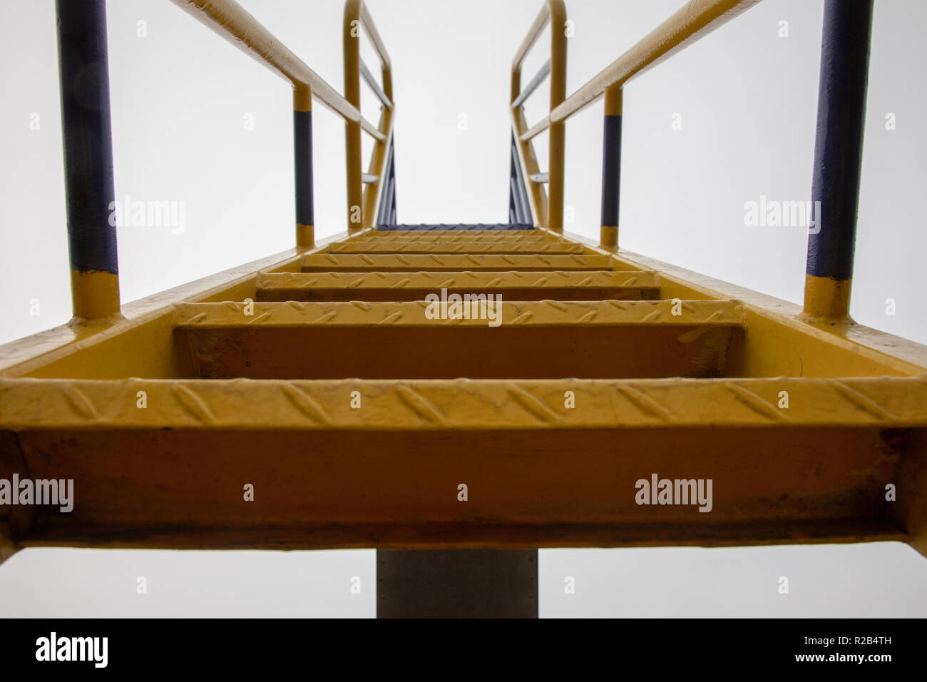 metal steps of a playground slide UK Stock Photo