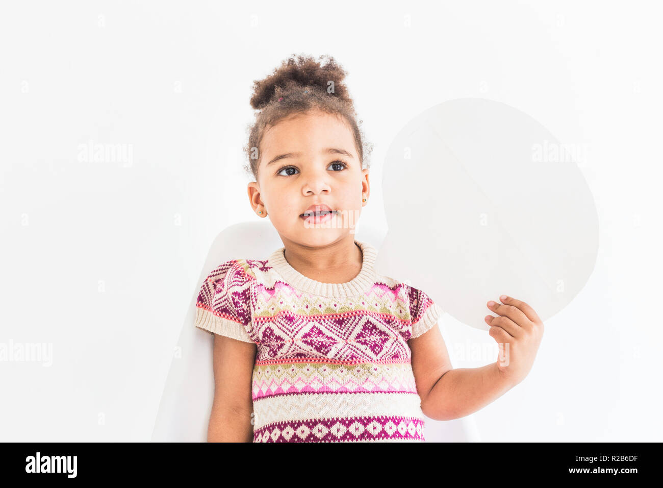 8ee2aa703d59 Portrait of a little girl in a colorful dress on a white background - Stock  Image