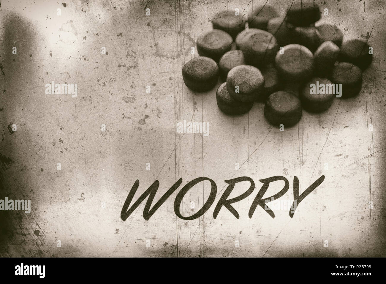 Concept of Worry and medical pills - Stock Image