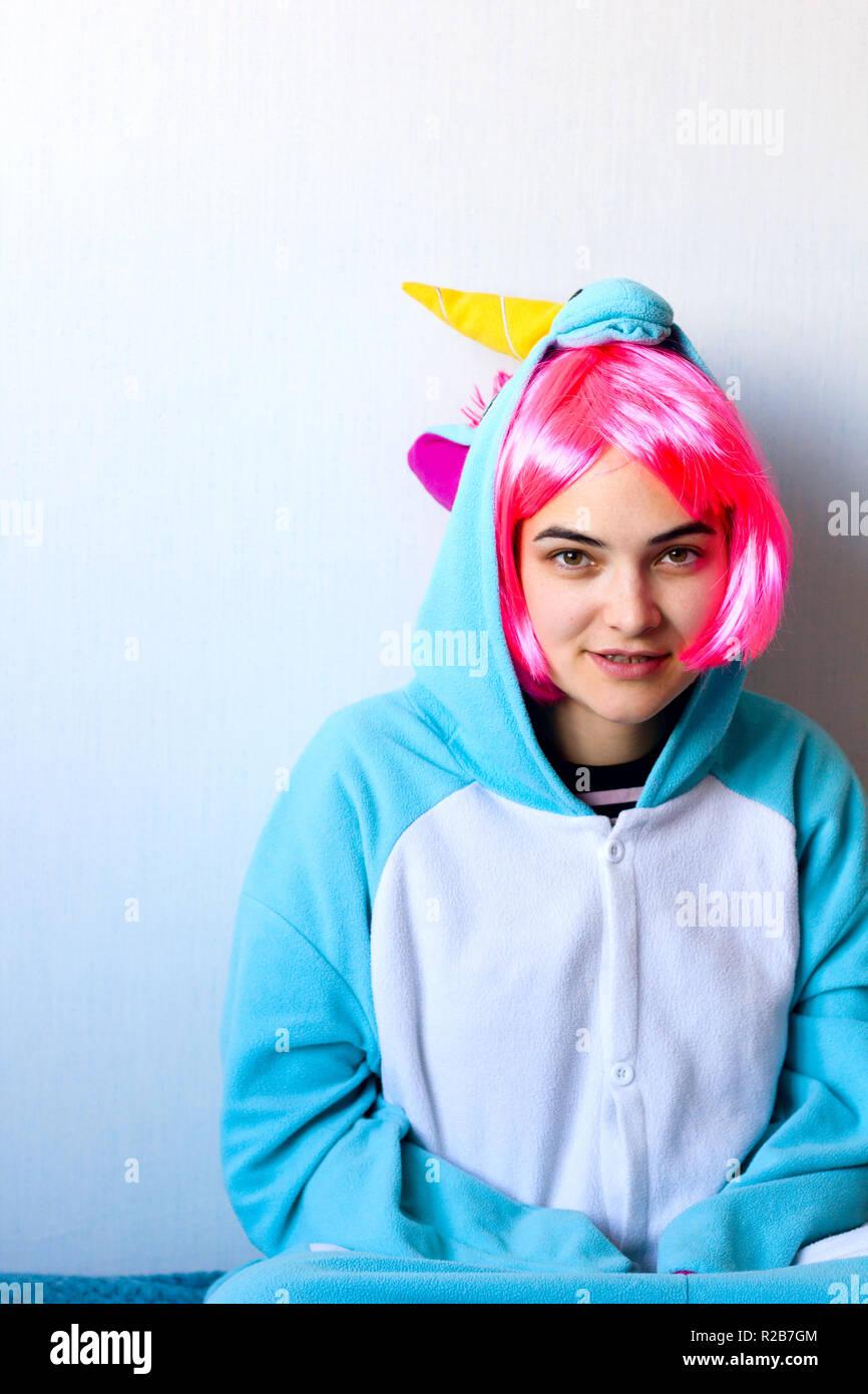 40b69a6902c75b cute girl in a pink wig in kigurumi unicorn pyjamas costume Stock ...