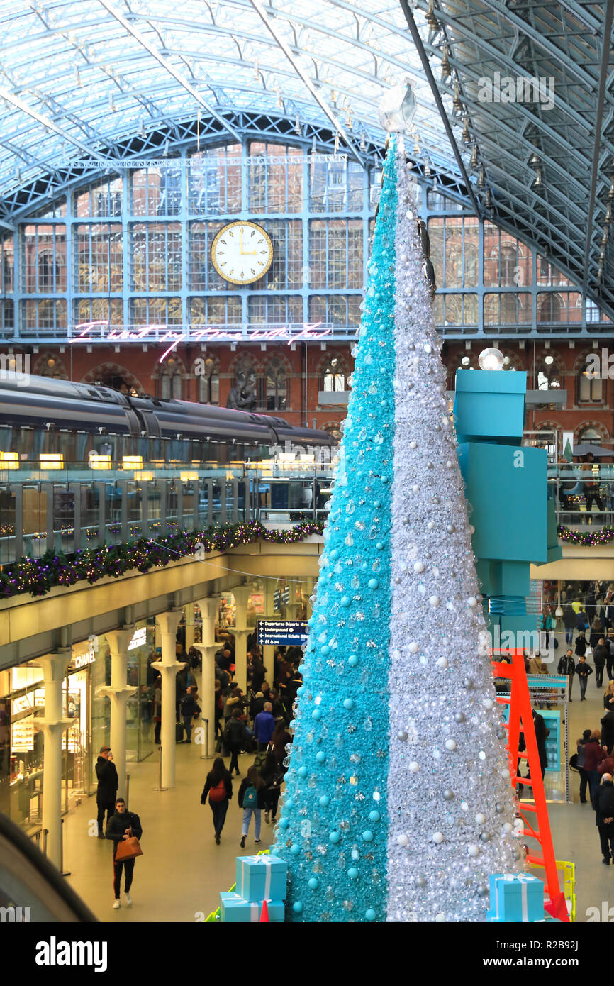 The Tiffany & Co's robot decorated Christmas tree in St Pancras International train station, in London, UK Stock Photo