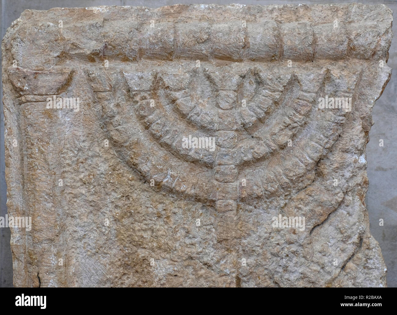Stone lintel decorated with Seven-Branched Menorah of an ancient synagogue from the 3rd-4th century CE found at Eshtemoa in the Southern Hebron hill region West Bank displayed at the Rockefeller Museum, that houses a large collection of artifacts unearthed in archaeological excavations conducted in Mandate Palestine, in the 1920s and 1930s located in East Jerusalem Israel - Stock Image
