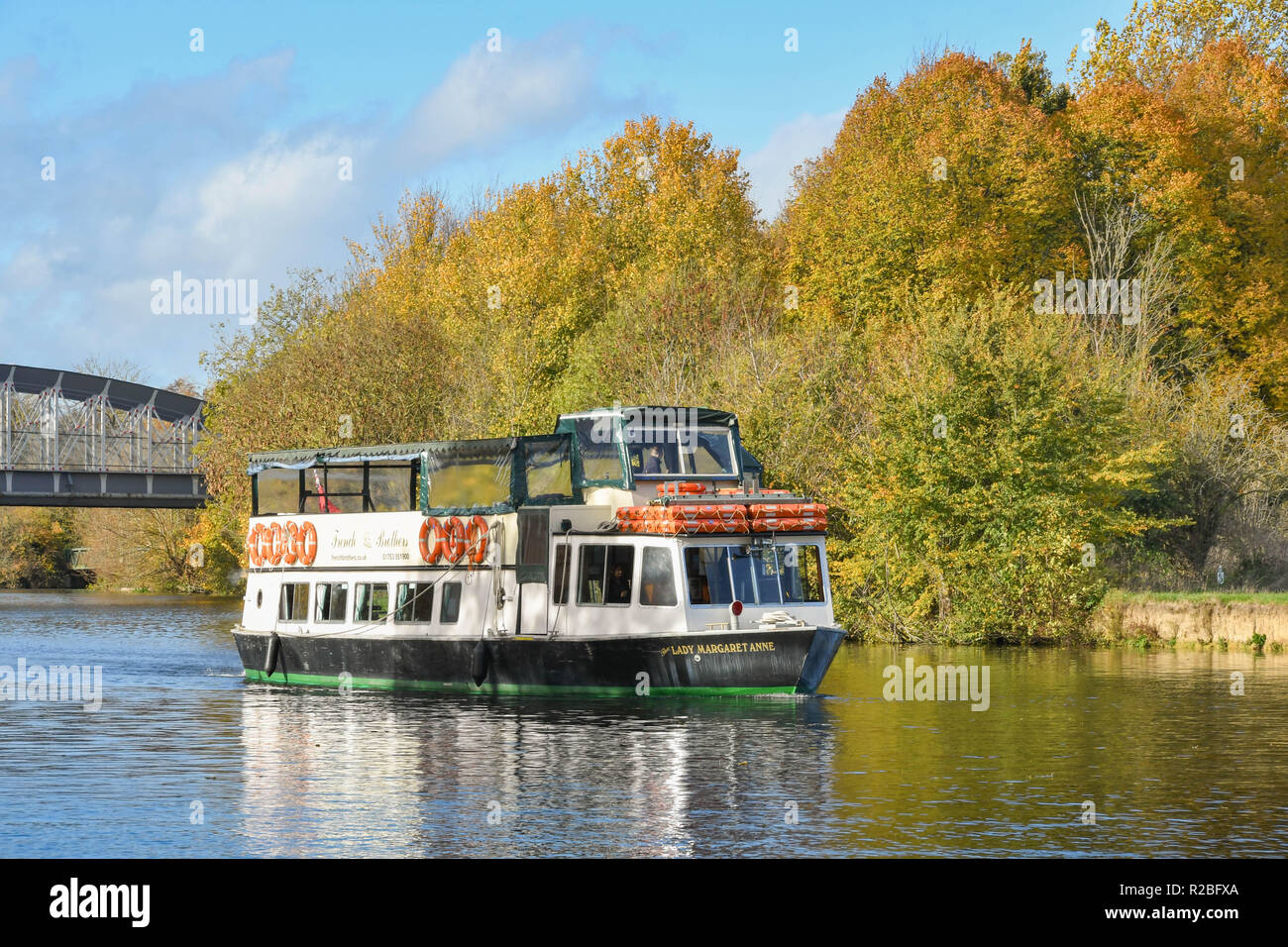 RIVER THAMES, WINDSOR, ENGLAND - NOVEMBER 2018: Tourist sightseeing boat cruising along the River Thames near Windsor. - Stock Image