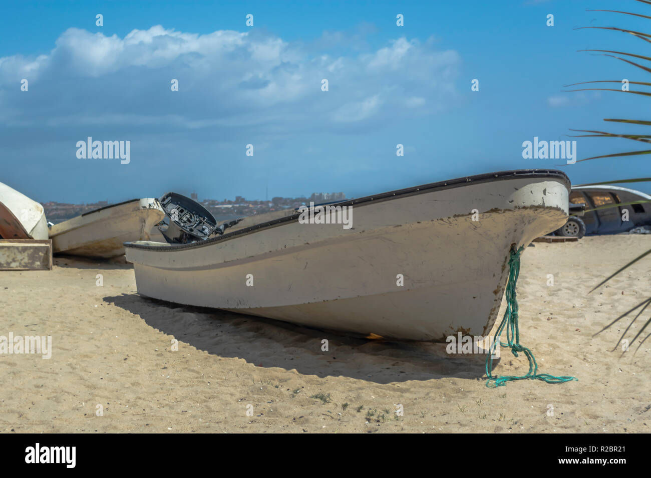 View of a broken fisherman's boat on a fisherman's beach, Mussulo island, Angola - Stock Image