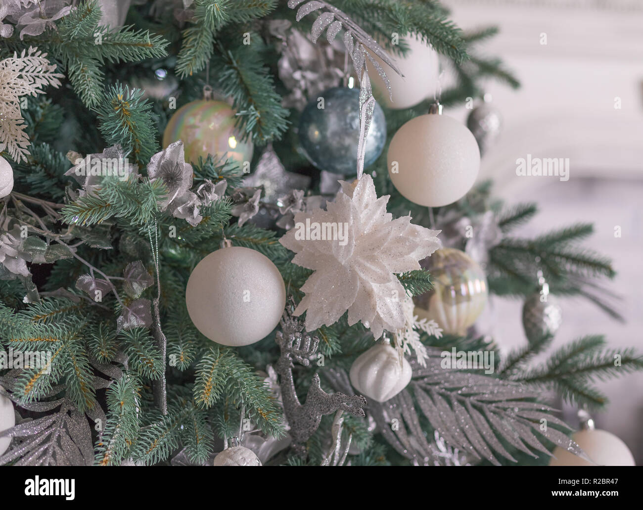 Pastel Christmas Ornaments.Silver Christmas Ornaments Hanging On Fir Tree Section Of A