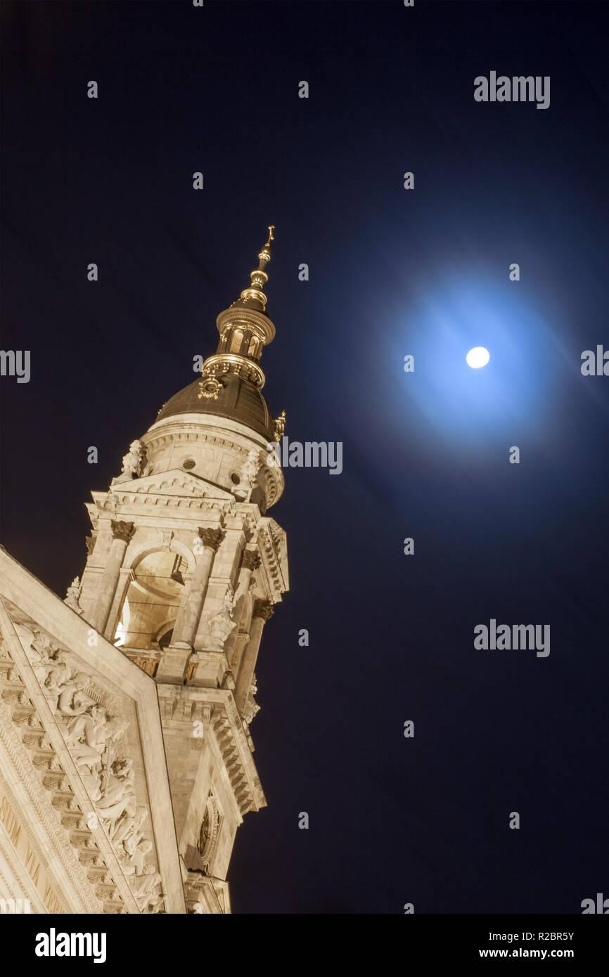 St.Stephen's Basilica against  full moon - Stock Image