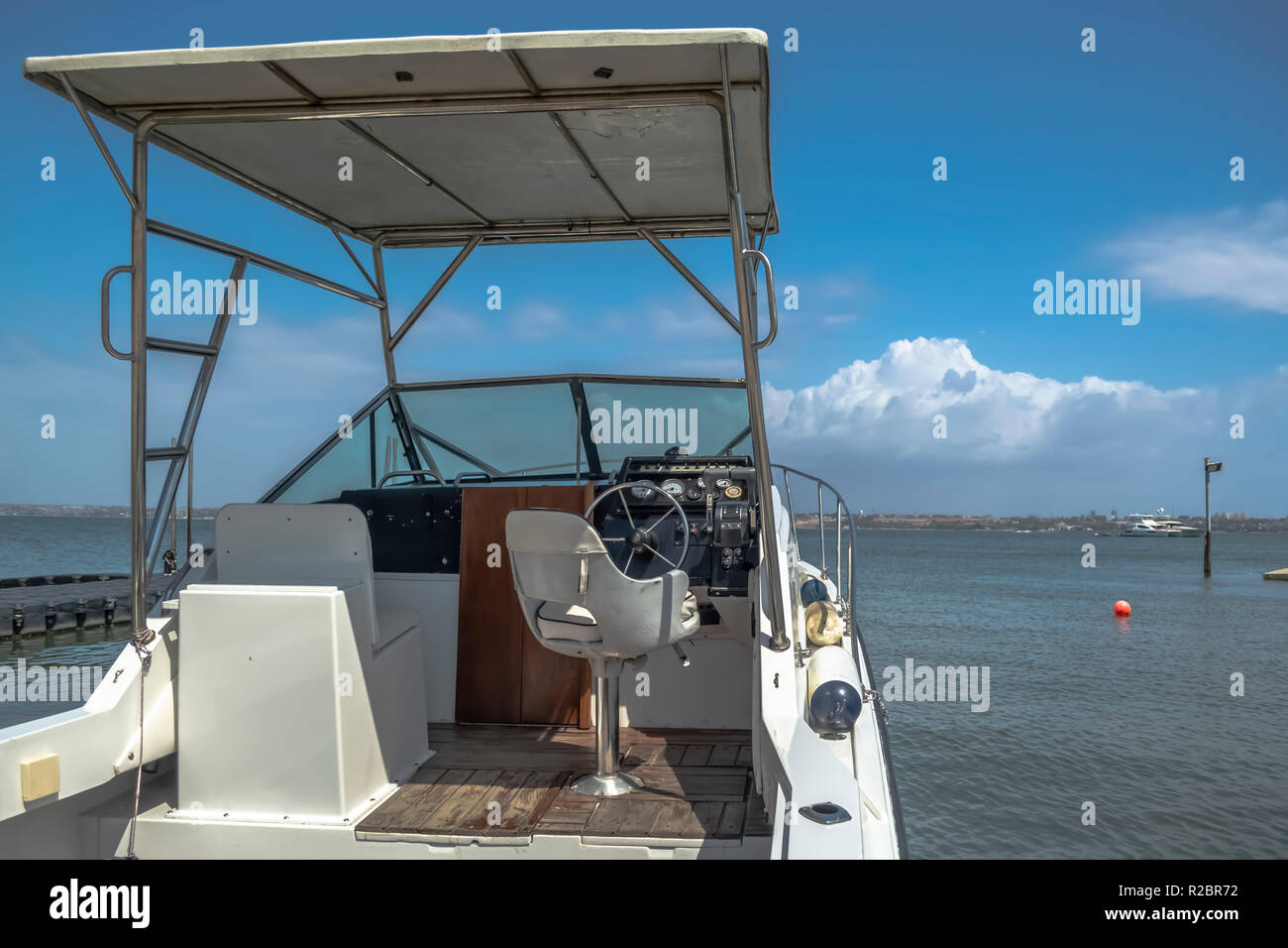 General exterior view of private recreational boat, parked at the beach in Mussulo island, Angola - Stock Image