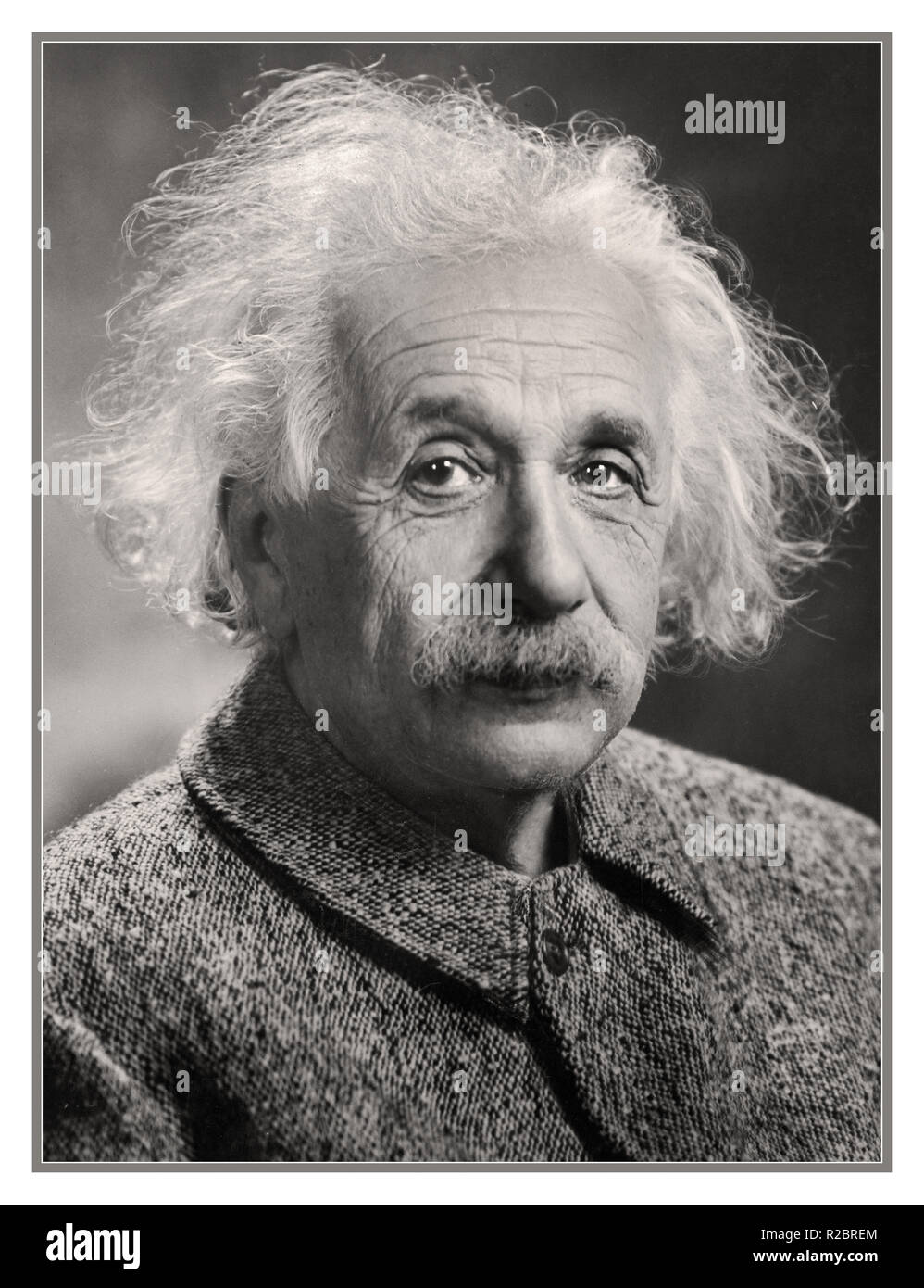 Albert Einstein theoretical physicist.  Albert Einstein was a German-born theoretical physicist who developed the theory of relativity, one of the two pillars of modern physics. His work is also known for its influence on the philosophy of science. Digitally enhanced image to produce original 1940's studio impact and quality. - Stock Image