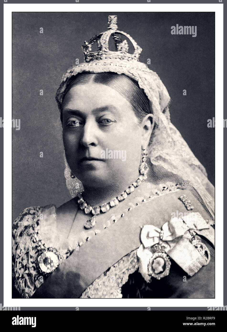 Queen Victoria 1887 British Monarch formal studio portrait wearing the Coronation Necklace and Earrings, small-Diamond Crown and Koh-i-Noor brooch The Small Diamond Crown of Queen Victoria is a miniature imperial and state crown made at the request of Queen Victoria in 1870 to wear over her widow's cap following the death of her husband, Prince Albert. It was perhaps the crown most associated with the Queen and is one of the Crown Jewels on public display in the Jewel House at the Tower of London. Photographer/Bassano - Stock Image