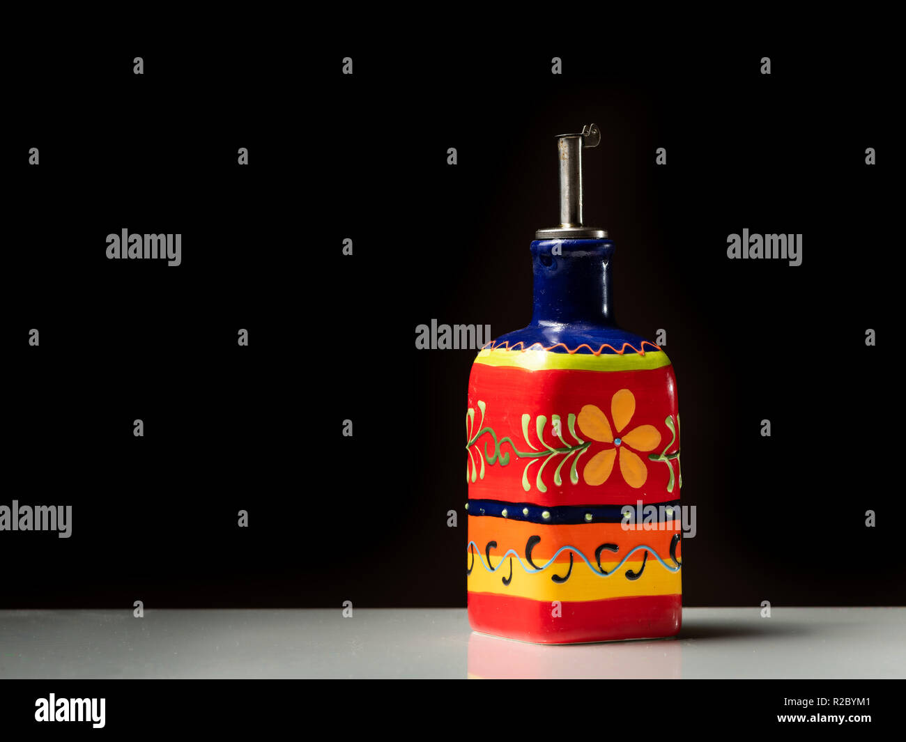 Closeup Of A Small Red Painted Bottle For Serving Olive Oil Black Background Stock Photo Alamy