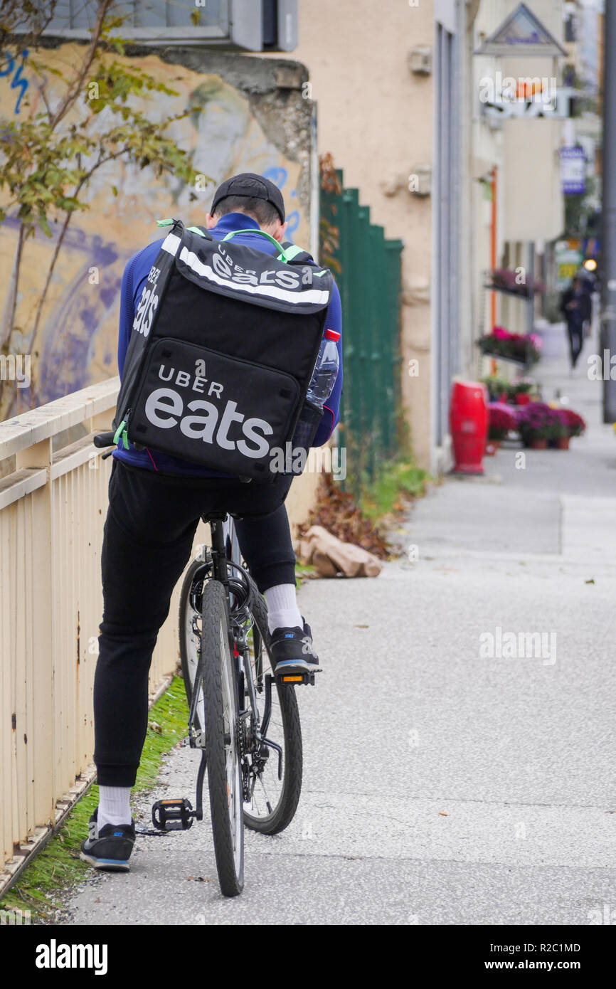 Uber Eats meal deliverer rides in Lyon, France Stock Photo