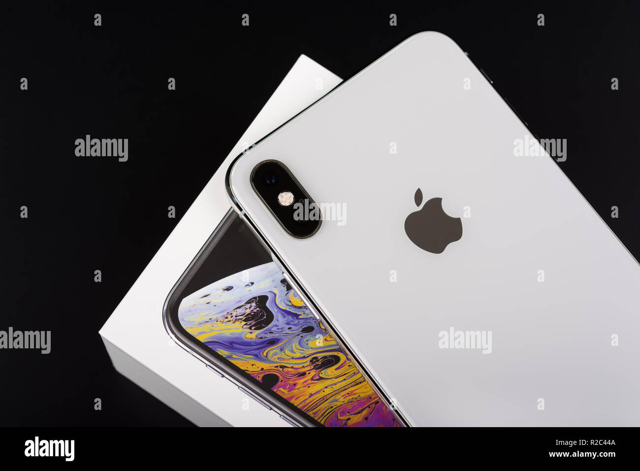 BURGAS, BULGARIA - NOVEMBER 8, 2018: Apple iPhone Xs Max Silver on black background, back view. - Stock Image