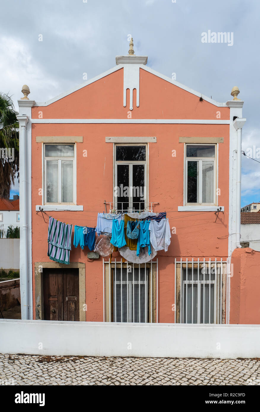 Hang drying clothes in colorful Lisbon Portugal - Stock Image
